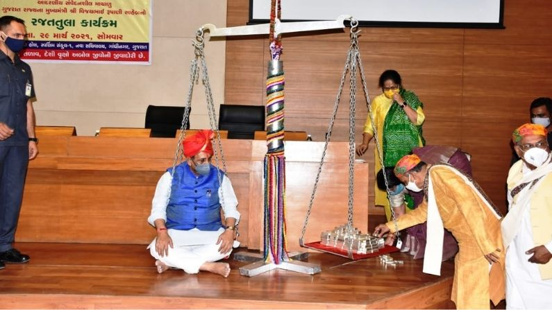 Gujarat CM Vijay Rupani weighed against 85kg of silver