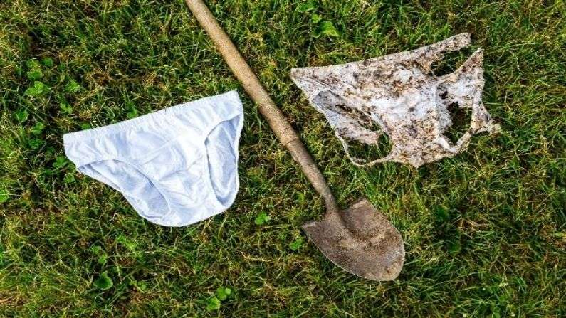 white underwear buried into the ground, to check the quality of the soil