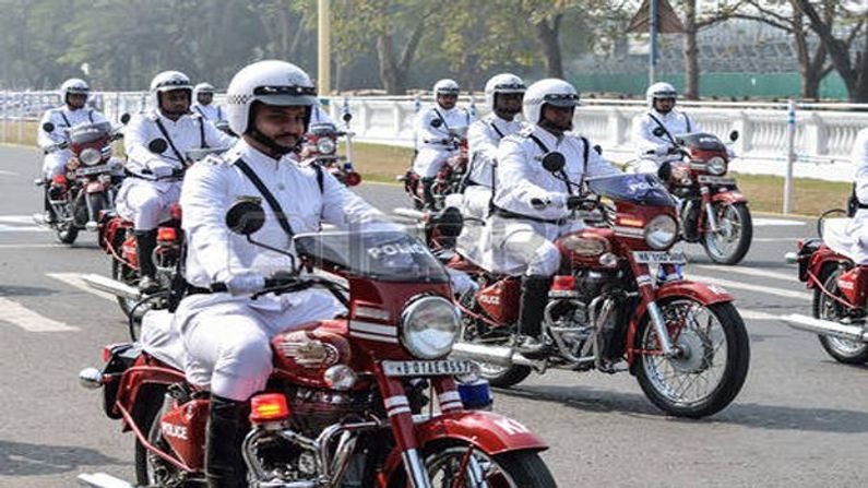 Kolkata police wear white uniform instead of khaki